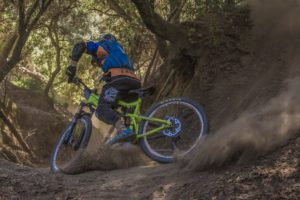 Mountain biker kicking up dust
