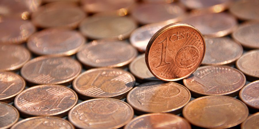 One Penny upright on other pennies