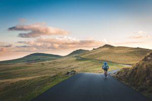 Man Bikes Downhill
