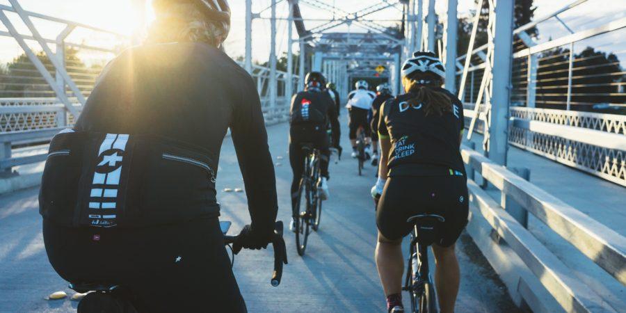 Bikers riding across a bridge