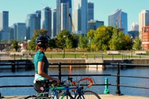 Ultimate Electric Bike Buying Guide: Woman overlooking downtown on a bike