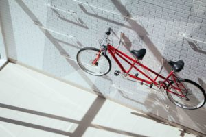 Tandem electric bike: A tandem bike on a wall