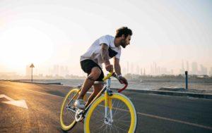 How To Increase Ebike Range: Man Pedalling Bike